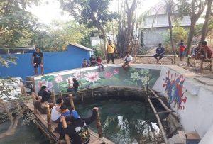 Tembok sumber air Mudal Pamotan saat dilukis mural oleh para pemuda, tahun 2019 lalu. (FB Pamotan).